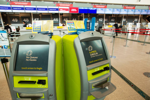 Express check in machines at Manchester Airport, UK.