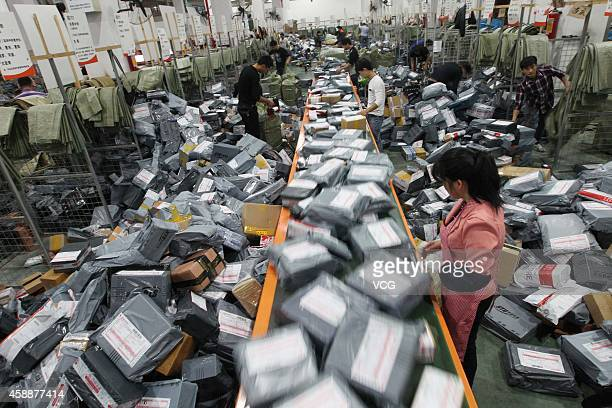 STO express crew deal with express packages at assembly line on November 12 2014 in Wenzhou Zhejiang province of China Online shopping websites...