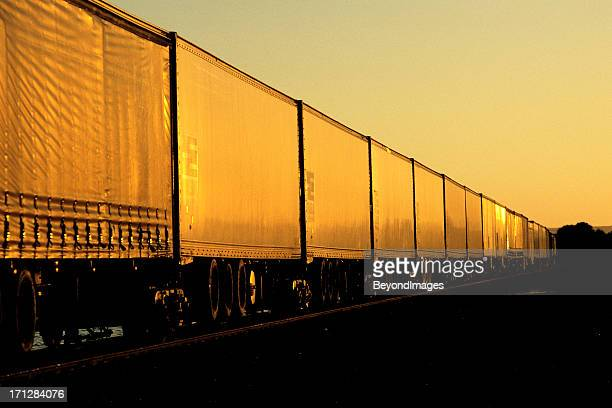 Express freight train heads into the sunset