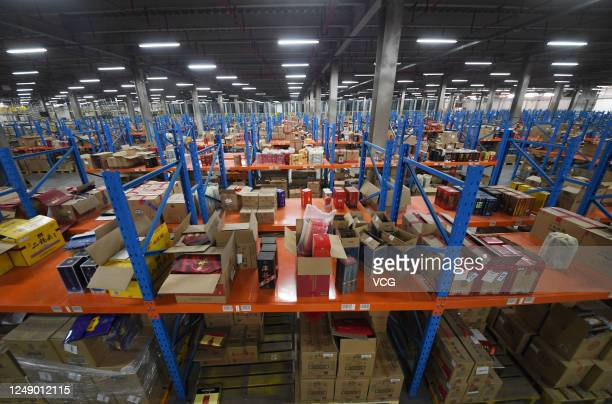 Express parcels sit stacked at a logistic base of e-commerce giant Suning before the upcoming 618 Shopping Festival on June 11, 2020 in Nanjing,...