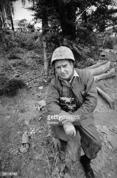 Express photographer Terry Fincher in Vietnam during the war 19th February 1968 He is carrying a Leica M3 and a Nikon F camera