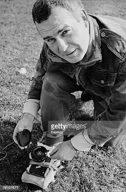 Express photographer Terry Fincher prepares to take a self portrait using a camera strapped to his foot, whilst parachuting from a hot air balloon,...