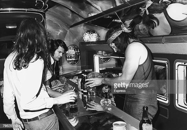 Express reporter Colin McKenzie at the bar on board a private Boeing 720B airliner known as 'The Starship' which is being used by English rock group...