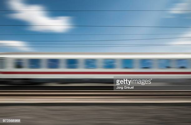 express train - blurred motion - railroad car stock pictures, royalty-free photos & images