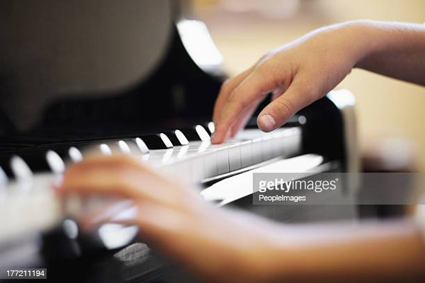 expressing his musical talent - grand piano stock photos and pictures