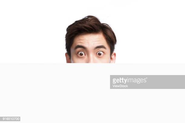 expressions of shock young man - human body part stock pictures, royalty-free photos & images