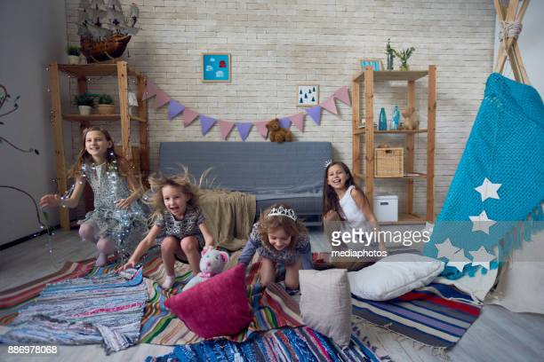 Expressive kids having fun in playroom