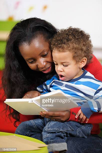 Expressive Toddler Enjoying Storytime With Carer