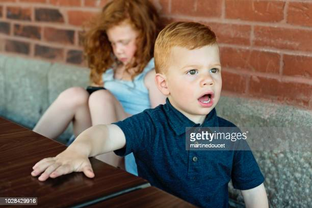 """expressives redhead kids outdoors on a brick wall. - """"martine doucet"""" or martinedoucet stock pictures, royalty-free photos & images"""