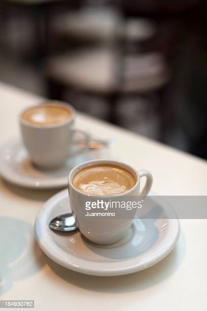 expresso coffee at the sidewalk cafe - two objects stock photos and pictures
