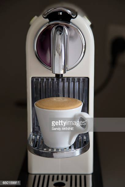 Expresso machine with full cup a coffee with foam