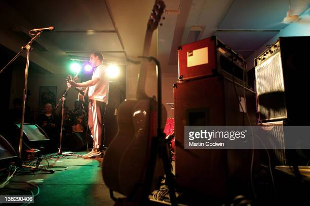 Exprisoner John singing and playing guitar in front of the audience at a benefit concert arranged by Billy Bragg for Jail Guitar Doors a programme he...