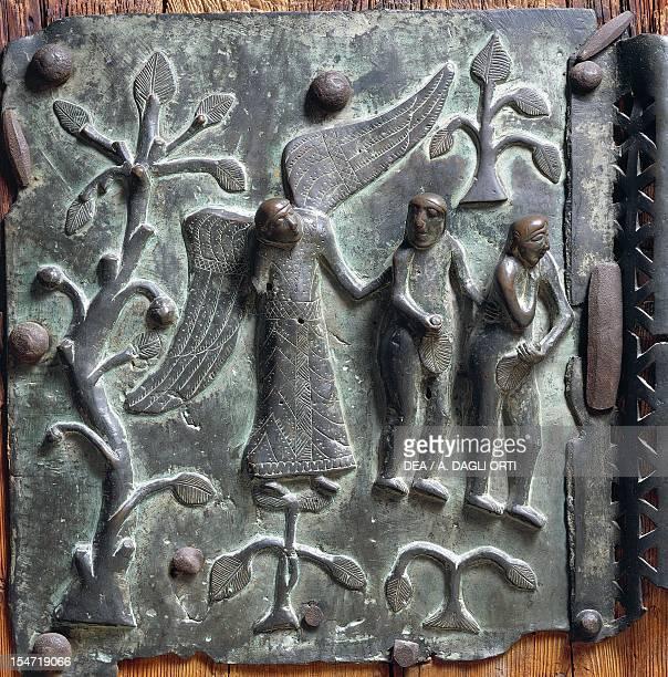 Expulsion from Eden bronze panel left wing of the portal Basilica of San Zeno Verona Veneto Italy 12th century