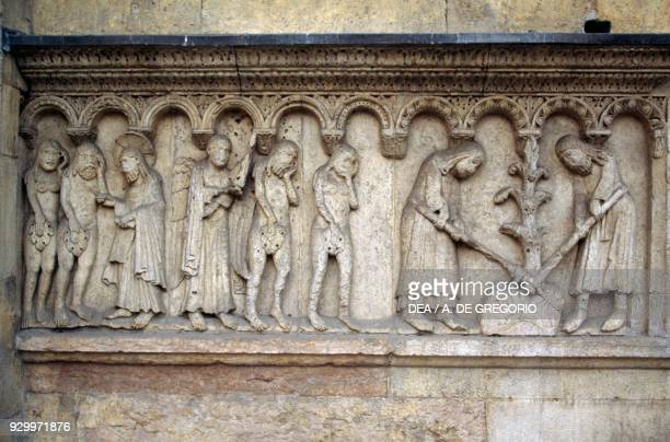 Expulsion from Paradise detail from Stories of Genesis by Wiligelmus marble basrelief facade of the Metropolitan Cathedral of Saint Mary of the...