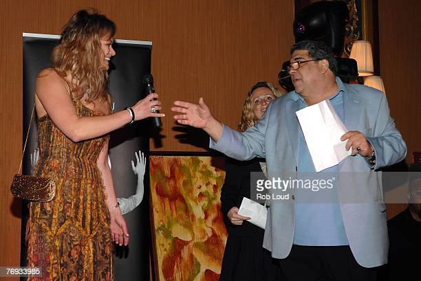 Exquisite Planning founder Natalia Sokolova and actor Vinnie Pastore lead an auction at the launch of Exquisite Planning at Prince George Ballroom on...