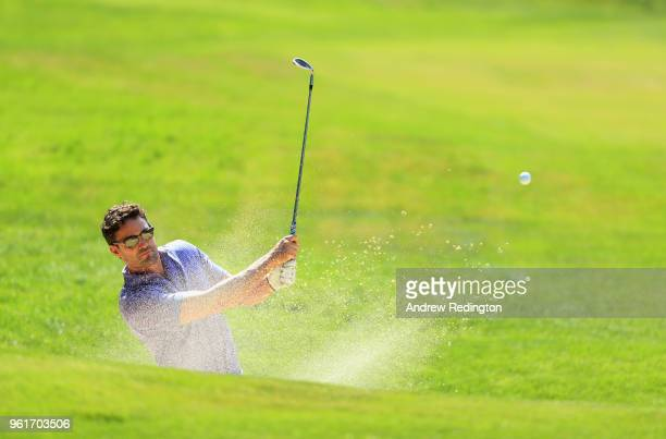 Exrugby player Thom Evans plays from a bunker during the BMW PGA Championship Pro Am tournament at Wentworth on May 23 2018 in Virginia Water England