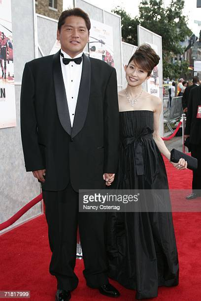 ExSeattle Mariners Pitcher Kazuhiro Sasaki and his wife arrive at the World Premiere of 'The Guardian' September 7 2006 in Washington DC