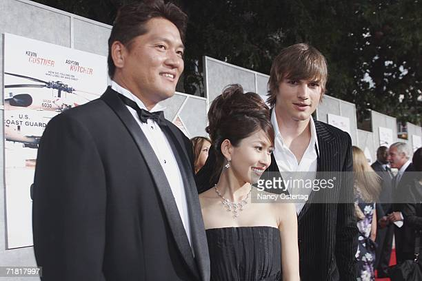 ExSeattle Mariners Pitcher Kazuhiro Sasaki his wife and Ashton Kutcher pose on the red carpet at the World Premiere of 'The Guardian' September 7...