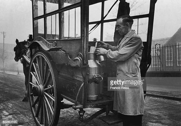 Exserviceman Trevor Ingham who now helps his father to run a dairy business at Whitefield near Manchester pouring out a pint of milk from a churn 4th...