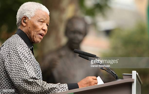 Ex-South African President Nelson Mandela addresses the crowd during a statue unveiling ceremony in his honour at Parliament Square on August 29,...