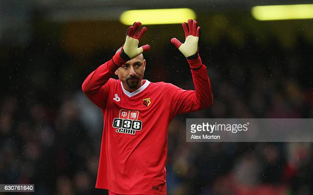 ExSpurs player Heurelho Gomes of Watford salutes the travelling fans during the Premier League match between Watford and Tottenham Hotspur at...