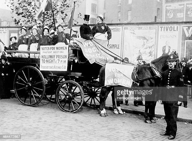 Exsuffragette prisoners wearing replica prison clothing advertise a 'protest meeting' to be held outside Holloway Gaol 7th November 1908 The...
