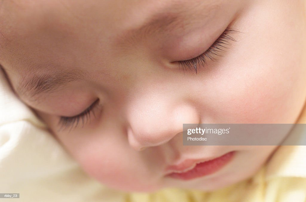 exteme close up on an asian babys face while it sleeps : Stockfoto