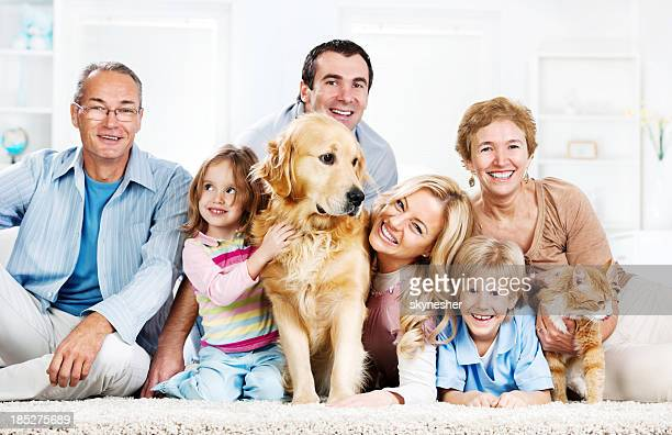 Extended cheerful family with pets.