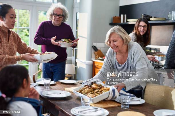 extended family having meal together - serving food and drinks stock pictures, royalty-free photos & images
