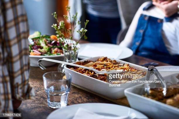 extended family having meal together - food stock pictures, royalty-free photos & images