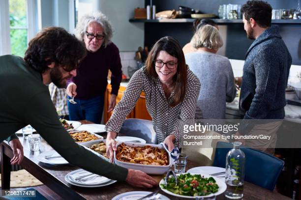 extended family having meal together - evening meal stock pictures, royalty-free photos & images