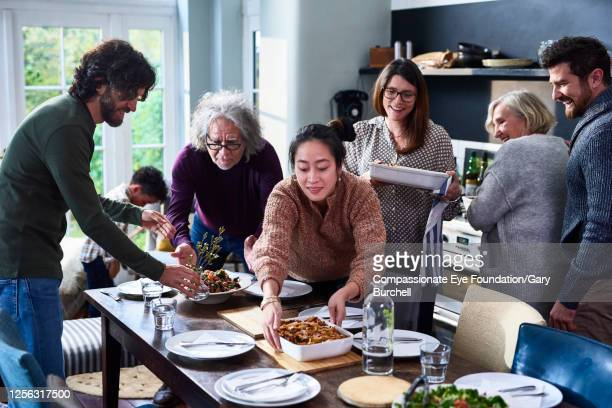 extended family having meal together - order stock pictures, royalty-free photos & images