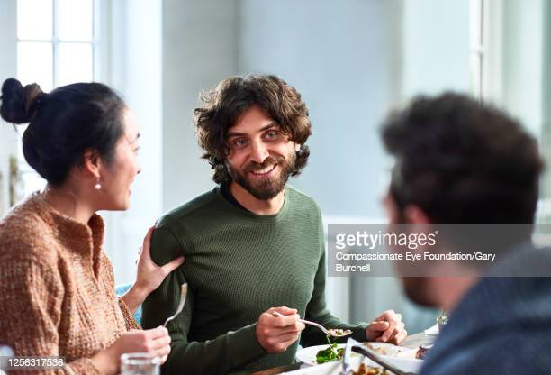 extended family having meal together - social gathering stock pictures, royalty-free photos & images