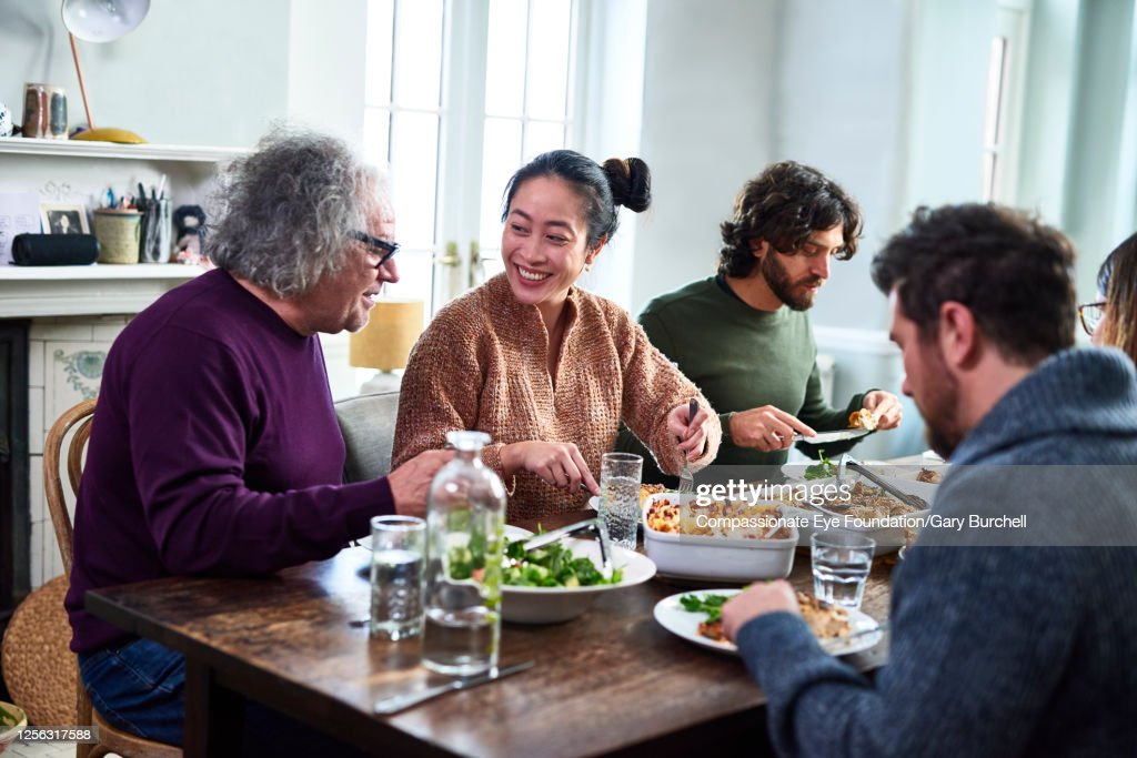 Extended family having meal together : Stock Photo
