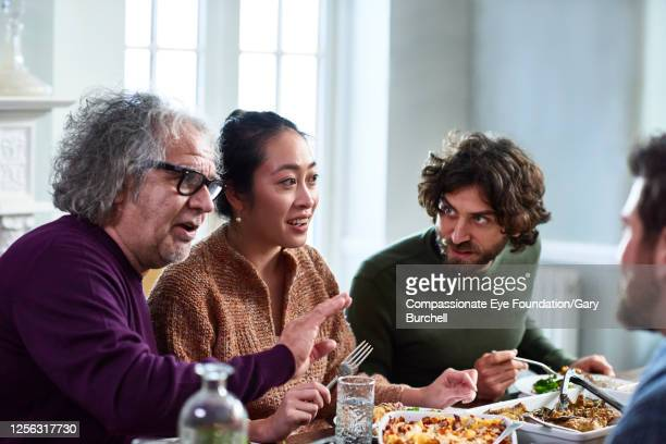 extended family having meal together - plate stock pictures, royalty-free photos & images