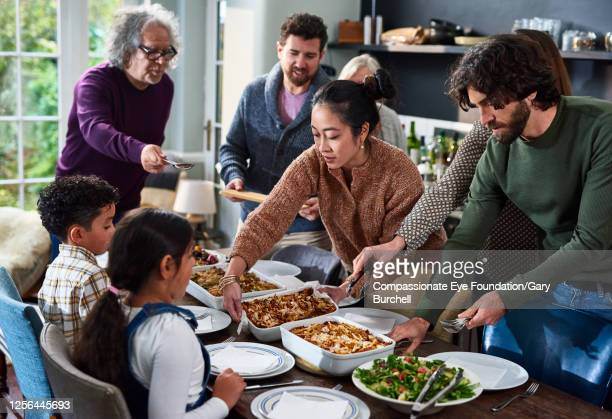 extended family having meal together - meal stock pictures, royalty-free photos & images
