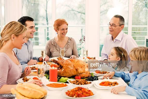 Extended family having thanksgiving dinner.