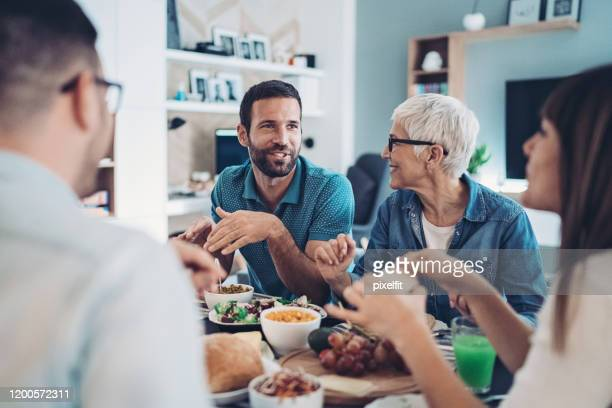extended family lunch - dinner stock pictures, royalty-free photos & images