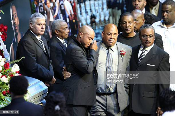 Extended family members of Lorenzen Wright grieve during a memorial service honoring the life of Lorenzen Wright on August 4 2010 at FedExForum in...