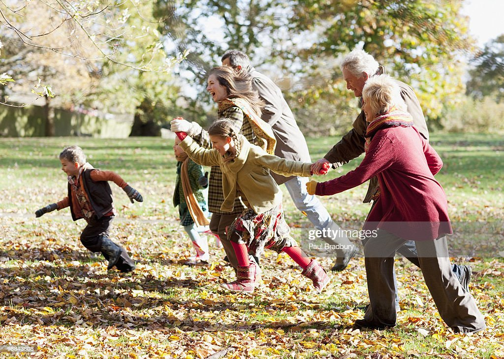 Extended family running in park : Stock Photo
