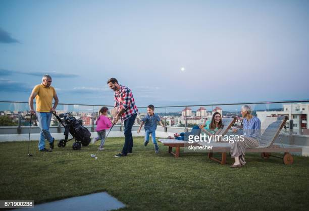 extended family spending a time on a penthouse terrace. - penthouse girls stock pictures, royalty-free photos & images
