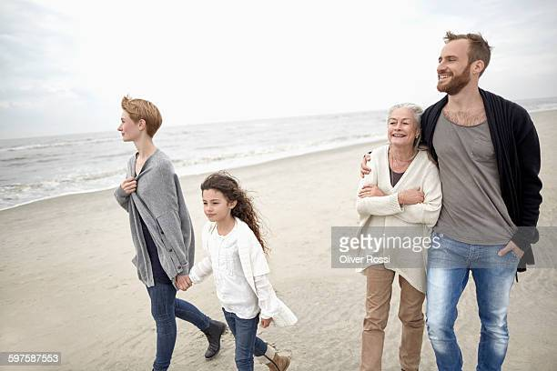 Extended family walking on the beach