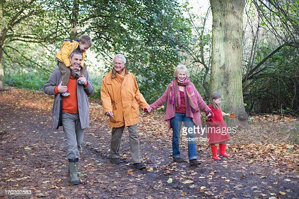 extended family walking outdoors in autumn - lane sisters stock photos and pictures