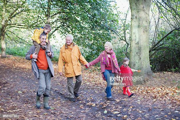 extended family walking outdoors in autumn - british granny stock photos and pictures