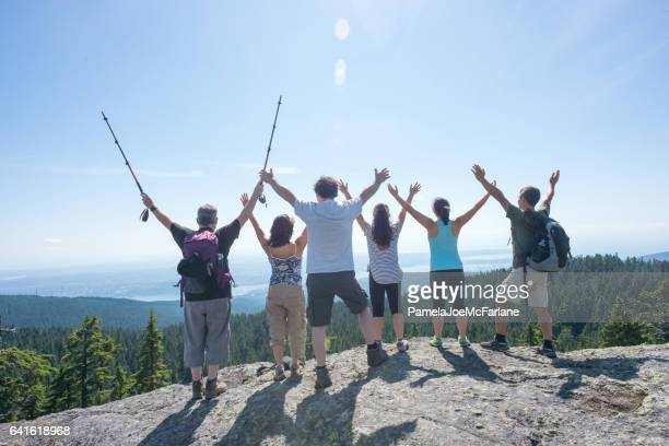 Extended Multi-Ethnic Family of Hikers Embracing Nature wtih Open Arms