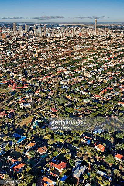 extensive aerial view over johannesburg city center showing all the highrise buildings and treelined suburbs surrounding it. gauteng province, south africa. - gauteng province stock pictures, royalty-free photos & images