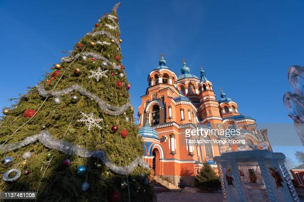 exteria of kasan church with christmas tree in front in irkutsk, russia - orthodox christmas stock pictures, royalty-free photos & images