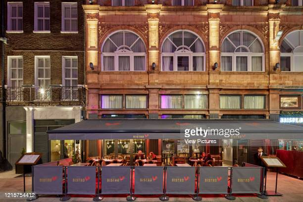 Exterior facade of restaurant at Victory House Hotel at night. Victory House Hotel, London, United Kingdom. Architect: Michaelis Boyd Associates Ltd,...