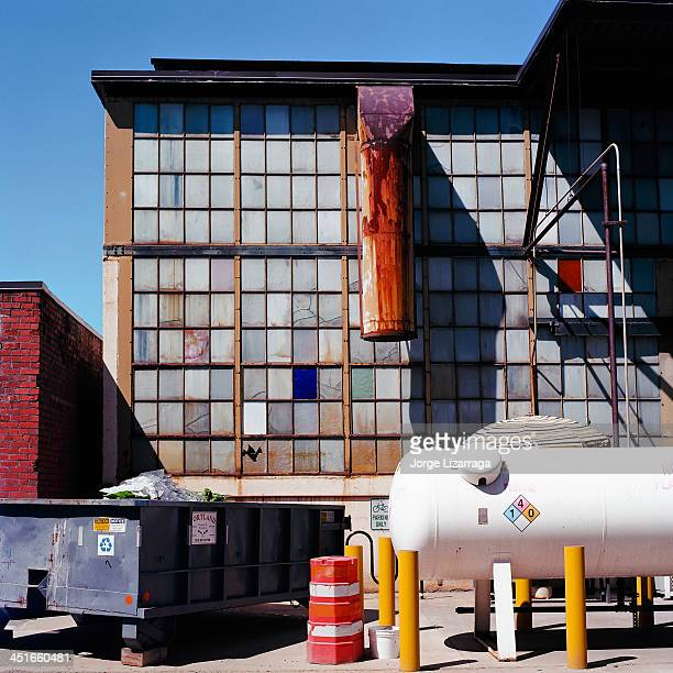 CONTENT] Exterior factory windows and exhaust vents in various colors Other details in scene include garbage containers compressed gas tank and...