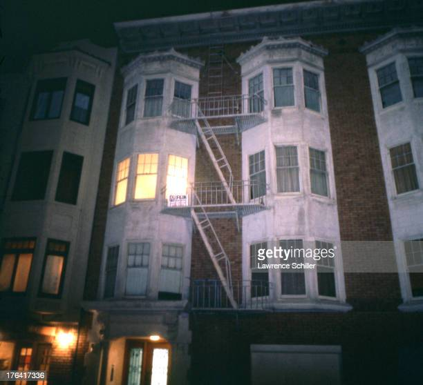 Exterior, nighttime view of an apartment building where heiress Patty Hearst was held captive after her kidnapping by the members of the Simbionese...